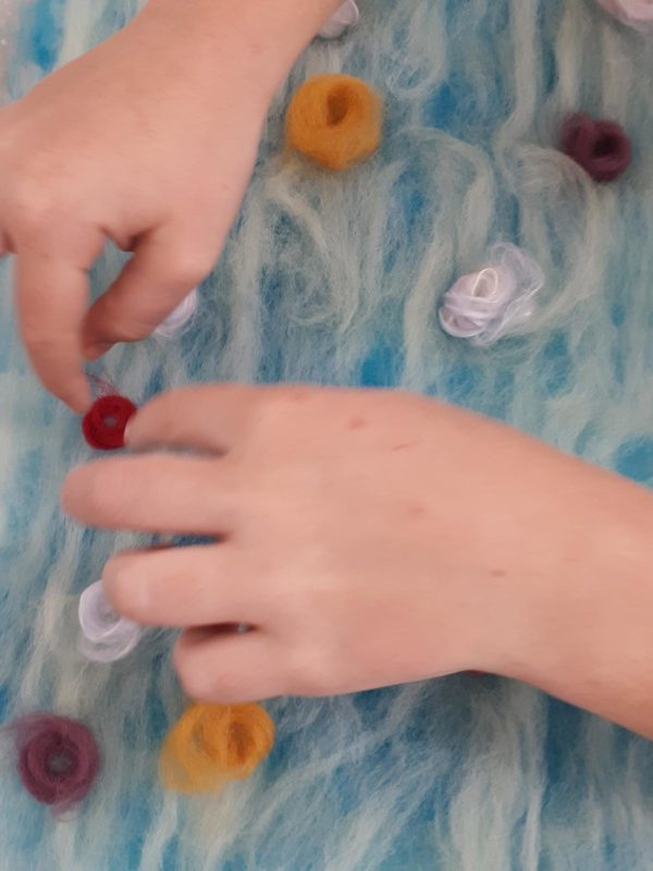 Two hands felting